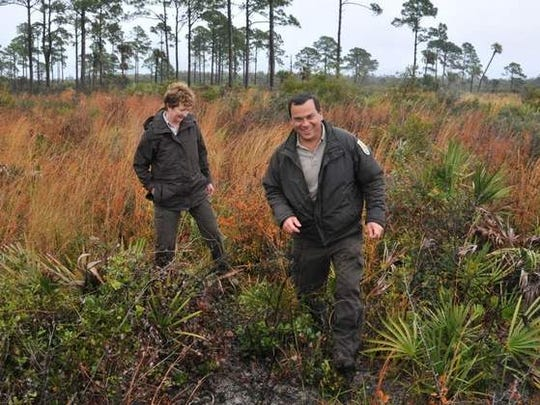 Federal wildlife officials say a plan to build a commercial launch complex in the Shiloh area could jeopardize valuable historic, cultural and natural resources on the Merritt Island National Wildlife Refuge. Layne Hamilton, reguge manager, and Mike Legare, wildlife biologist, both with US Fish and Wildlfe, walk the flatwoods scrub in the Shilo area.