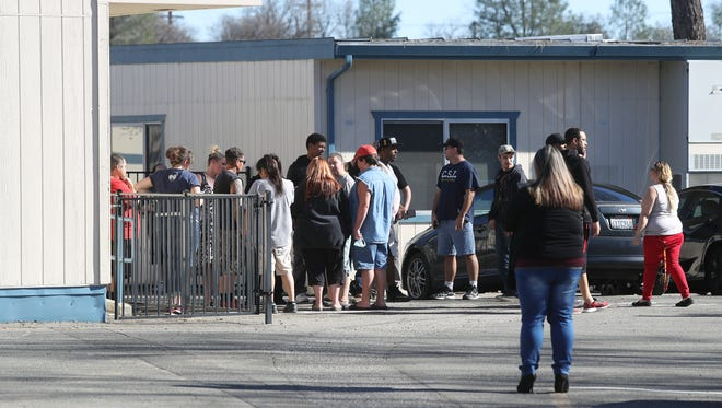 Parents wait to pick up their children on Feb. 7 at Buckeye School of the Arts after a police-involved shooting nearby.