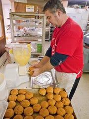 Owner Dan Cox fills paczki for customers.