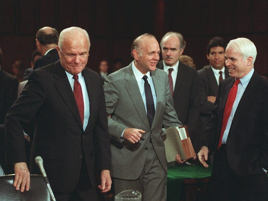 Sens. John Glenn (left), D-Ohio, Dennis DeConcini, D-Ariz., and John McCain (right), R-Ariz., arrive at the Senate Ethics Committee hearing room Nov. 15, 1990, on Capitol Hill. Five senators are to face charges that they took part in alleged influence peddling to help former savings and loan owner Charles H. Keating, Jr.