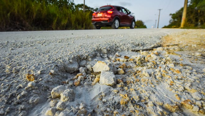 Signs of deterioration and erosion can be seen on and along the edge of Lucas Sablan Boulevard in Yigo as a motorist drives by on the evening of Thursday, March 8, 2018.