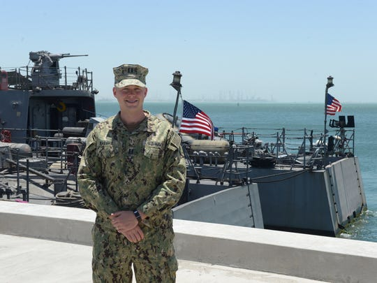 Lt. Javan Rasnake stands on the pier at Naval Support Activity Bahrain in Manama, Bahrain.