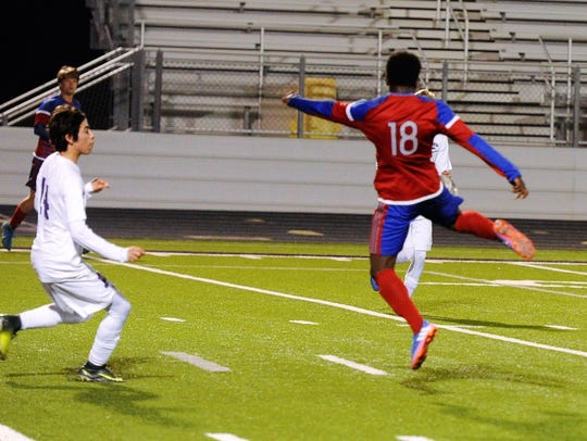 Cooper's Asende Lokendo (18) turns to hit what would