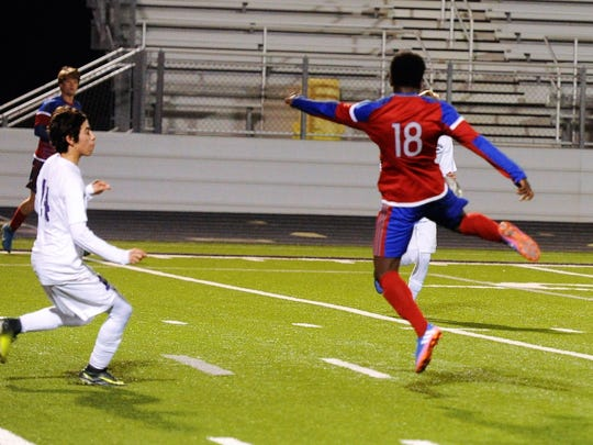 Cooper's Asende Lokendo (18) turns to hit what would be the game-winning goal on Monday, Feb. 5, 2018. The Cougars defeated Wylie 2-1 at Bulldog Stadium.