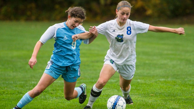 Colchester's Avery Finelli, right, is chased by South Burlington's Bella Nevin on Wednesday, October 11, 2017.