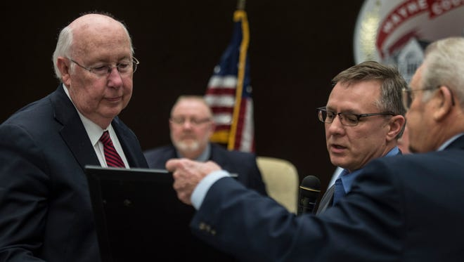 State Sen. Jeff Raatz and State Rep. Dick Hamm present Wayne County Commissioner Ken Paust with the Circle of Corydon award during a joint meeting of the commissioners and county council on Wednesday, March 21, 2018.