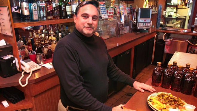 Bill Smythe, owner of Claude & Annie's, 9251 E. 141st St., Fishers, is against a proposed one percent food and beverage tax for the town of Fishers.