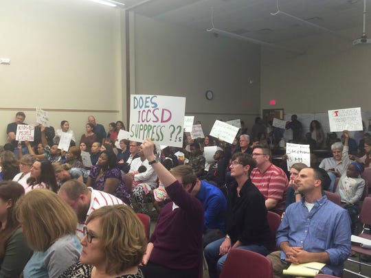 Residents gathered at the Iowa City Community School Board's meeting on May 10, 2016, to speak on a decision to place the district's homeless liaison on leave.