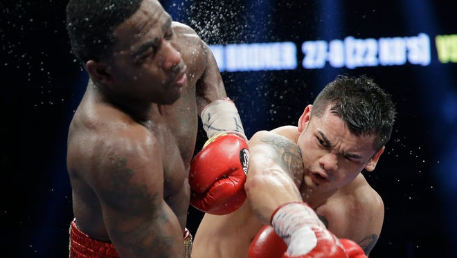 Marcos Maidana, right, lands a punch on Adrien Broner, during their WBA welterweight title bout on  Dec. 14 in San Antonio. Maidana will fight Floyd Mayweather on May 3.