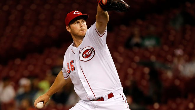 Cincinnati Reds relief pitcher Blake Wood (36) delivers in the 10th inning.