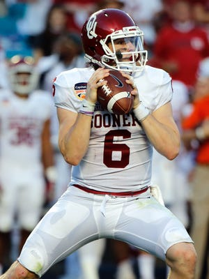 Oklahoma Sooners quarterback Baker Mayfield (6) throws a pass against the Clemson Tigers in the second quarter of the 2015 CFP Semifinal at the Orange Bowl at Sun Life Stadium.