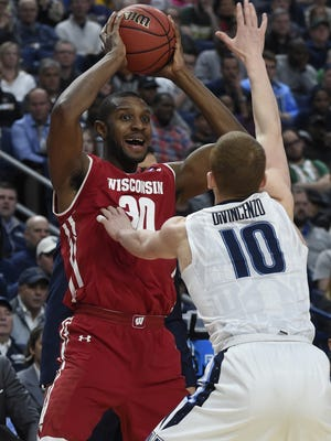 Guarded by Villanova?s Donte DiVincenzo, Badgers forward Vitto Brown looks to find an open man on Saturday. Mar 18, 2017; Buffalo, NY, USA; Wisconsin Badgers forward Vitto Brown (30) looks to pass against Villanova Wildcats guard Donte DiVincenzo (10) in the first half during the second round of the 2017 NCAA Tournament at KeyBank Center. Mandatory Credit: Mark Konezny-USA TODAY Sports