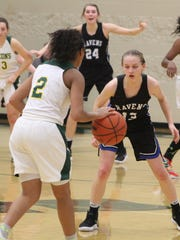 Royal Oak freshman Sarah Soraghan defends Groves senior