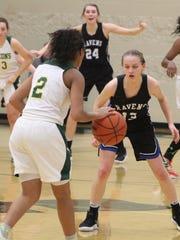 Royal Oak freshman Sarah Soraghan defends Groves senior guard Sacha Tyler.