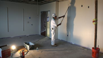 John Walsh painting a classroom in School 12.