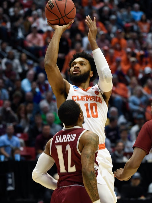Clemson guard Gabe DeVoe (10) shoots as New Mexico State guard A.J. Harris (12) looks on during the first half of a first-round NCAA college basketball tournament game Friday, March 16, 2018, in San Diego. (AP Photo/Denis Poroy)
