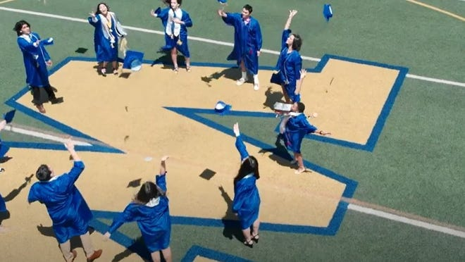 Some Wooster High School seniors toss their caps into the air in a prerecorded video aired during the virtual commencement ceremony.