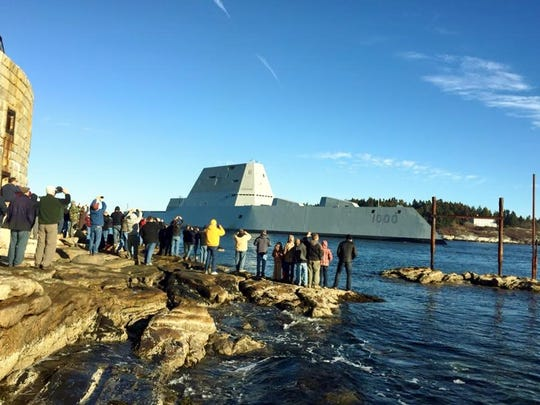 """The first Zumwalt-class destroyer, PCU Zumwalt, the largest-ever built for the U.S. Navy, passes spectators Monday at Fort Popham at the mouth of the Kennebec River in Phibbsburg, Maine. The ship is the first of a new class of destroyers named after Tulare native Adm. Elmo """"Bud"""" Zumwalt Jr"""