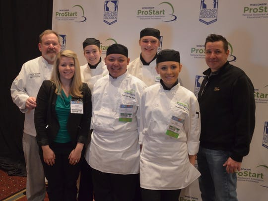 Greendale's four students who competed at the ProStart culinary competition pose for a photo with mentor Tom Surwillo (left), teacher Kayla Correll, and Brian Frakes (right).