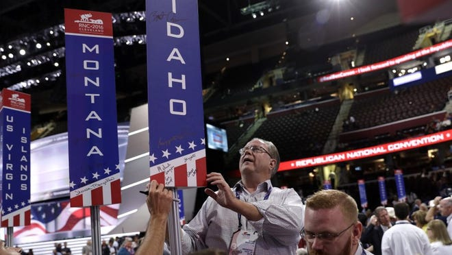 Rod Beck of Boise Idaho looks at the signatures of the post before the start of the third day session of the Republican National Convention in Cleveland, Wednesday, July 20, 2016. (AP Photo/John Locher)