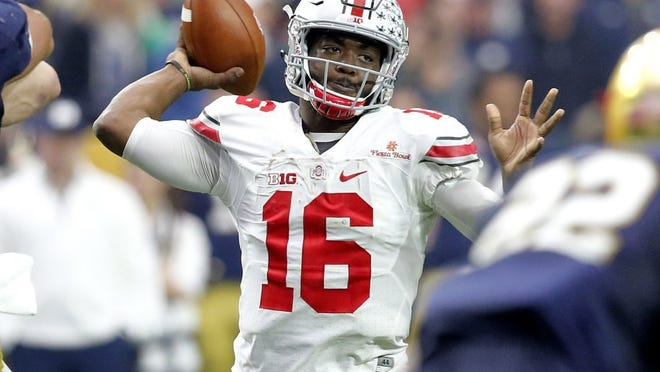 FILE - In this Jan. 1, 2016, file photo, Ohio State quarterback J.T. Barrett (16) throws a pass against Notre Dame during the second half of the Fiesta Bowl NCAA College football game in Glendale, Ariz. Last year Ohio StateþÄôs offensive engine was powered mostly by All-American tailback Ezekiel Elliott, and the passing game took a back seat. Coach Urban Meyer wants to change that. (AP Photo/Ross D. Franklin, File)