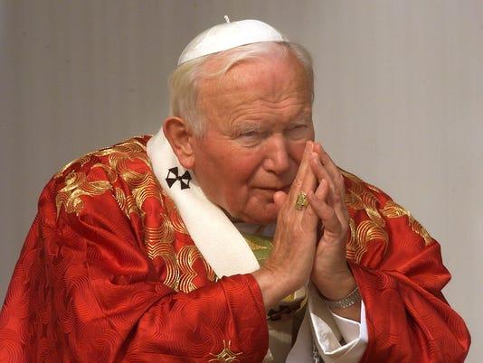 Pope John Paul II prays 11 October on Sa