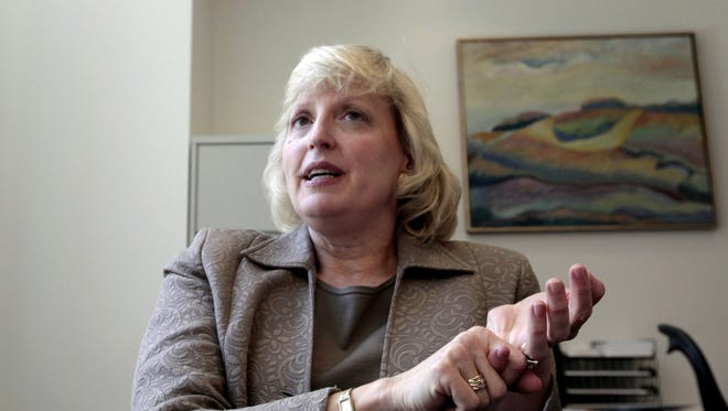Alison Davis-Blake will be the dean of the University of Michigan's Ross School of Business for another year, before she steps down. She is the business school's first female dean.