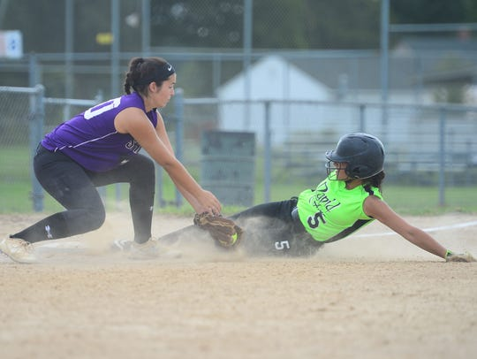 The Salisbury Sharks' Olivia Welch applies the tag