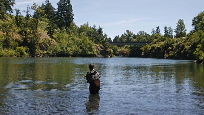 An angler fishes on the South Santiam River near the Pleasant Valley boat ramp, where a teenager drowned on Thursday.