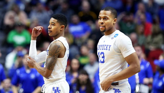 Kentucky's Isaiah Briscoe, right, and Tyler Ulis take to the floor before the game against Stony Brook. 