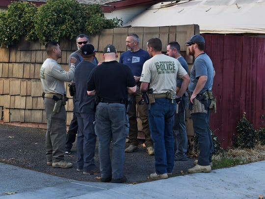 US Marshals gather at Greenbrae Drive and 11th Street in Sparks where an arrest was make after a car crash in the Sparks community Nov. 21, 2017.