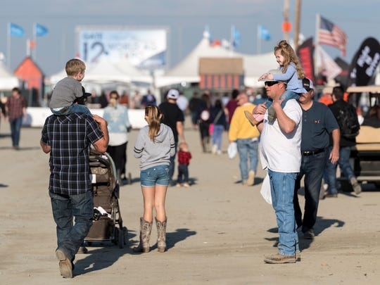 Visitors leave the World Ag Expo at the International