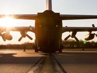 1st Lt. Alex Sutherland, a C-130 navigator, participates in preflight checks in New Castle.