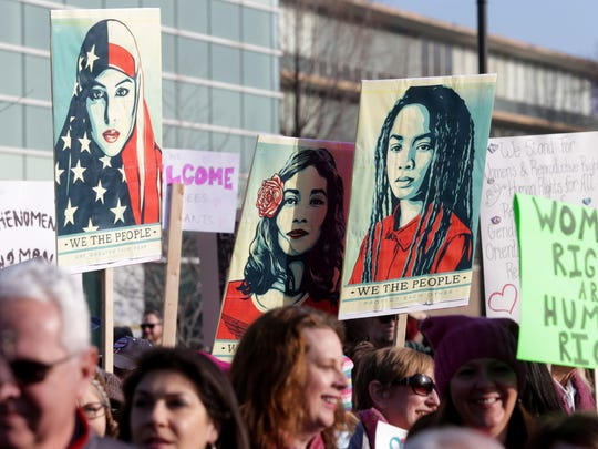 Many signs on display and being carried during the