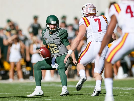 Baylor Bears quarterback Charlie Brewer (12) is pressured
