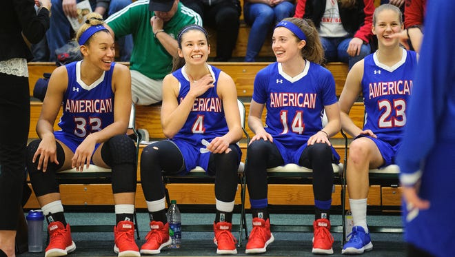 American's Emily Kinneston (4) sits on the bench waiting for the starting line up introductions during the women's basketball game between the American Eagles and the Vermont Catamounts in the first game of the TD Bank Classic at Patrick Gym on Friday.