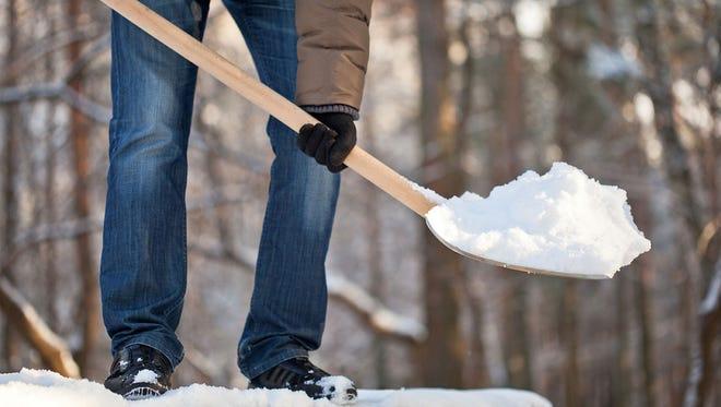 Safe snow shoveling: Warm up, bend your knees and breathe