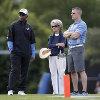 From left, Detroit Lions general manager Martin Mayhew, owner Martha Firestone Ford and president Tom Lewand watch practice July 29, 2014.