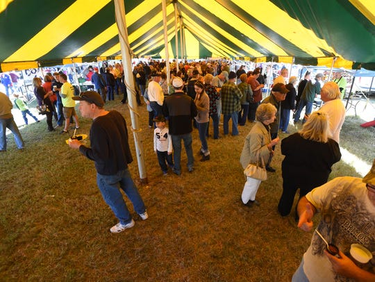 Hillbilly Chili attendees wander through the tasting
