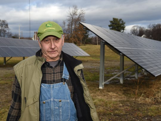 William Werba of Milton near the solar panel array
