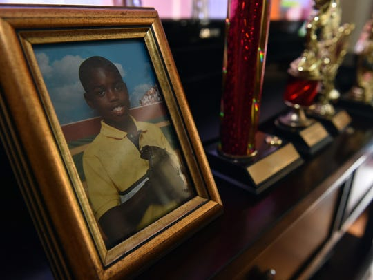 A photograph of Melvin Mangum Jr. near a row of his trophies at his mother's home in Jackson Wednesday. Melvin Mangum Jr. died at age 18, May 22.