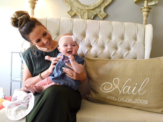 Catherine Nail plays with daughter Lillian Catherine.