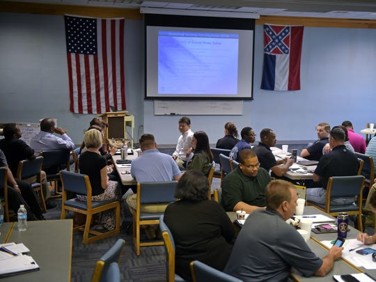 Law enforcement officers attend a class aimed at identifying and combating human trafficking at the Mississippi Law Enforcement Officers' Training Academy in Pearl Wednesday.