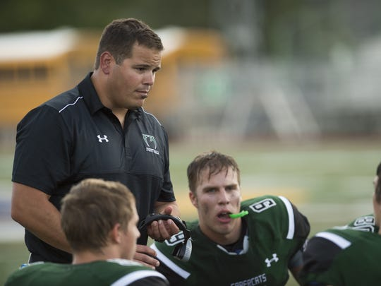 Brian Tinker Fossil Ridge High School football coach Brian Tinker speaks with the team during a time out Thursday, September 3, 2015.