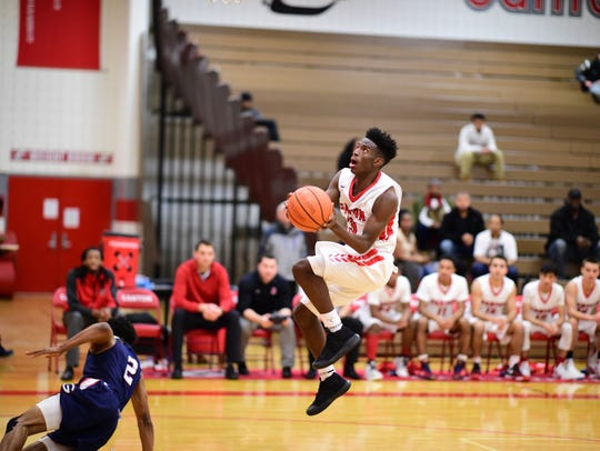 Taking the ball to the basket Tuesday night is Vinson