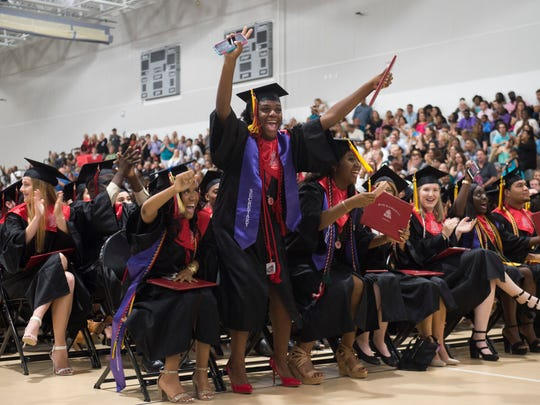 """Class treasurer Vanessa Smith, 17, (from left) class secretary Judy Cadet, 17, and class president Jane Badio, 18, all of Port St. Lucie, erupt in celebration after Port St. Lucie High School graduated 393 students Tuesday, May 22, 2018 during the commencement ceremony at the Havert L. Fenn Center in Fort Pierce. """"I'm happy,"""" Smith said, with Badio adding that she feels """"really good."""""""