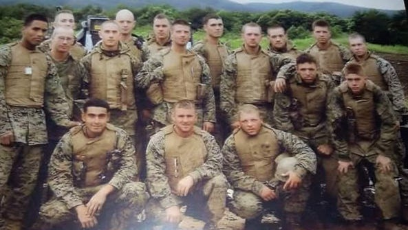 Pictured are Gunnery Sgt. Thomas Sullivan, front-center, with fellow Marines. Bradley Kendzierski stands two rows back in the middle.