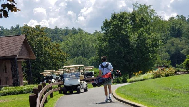 A golfer makes his way up to the clubhouse on Monday at Crooked Creek Golf Club. The club will be hosting the 50th Apple Jack Amateur Championship on Sept. 12-13.