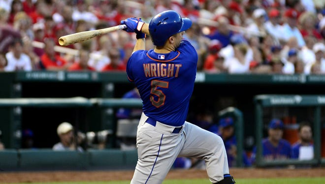 Mets third baseman David Wright hits a solo home run off of Cardinals starting pitcher Michael Wacha in the fourth inning.