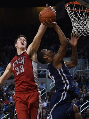 Nevada's D.J. Fenner has his shot blocked by UNLV's Stephen Zimmerman Jr. during their game in Reno this season.